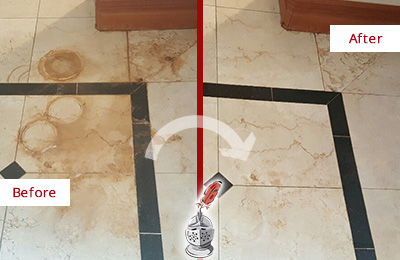 Before and After Picture of a Dagsboro Hard Surface Restoration Service on a Marble Floor to Eliminate Rust Stains